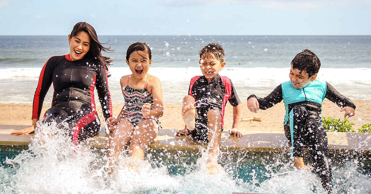 Happy kids at a beach-side pool